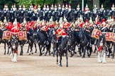 Major General's Review 2013: The Ride Past - the Mounted Bands of the Household Cavalry move, from the eastern side, onto Horse Guards Parade. The Director of Music of the Household Cavalry, Major Paul Wilman, The Life Guards followed by the kettle drummer from The Life Guards.. Horse Guards Parade, Westminster, London SW1,  United Kingdom, on 01 June 2013 at 11:50, image #580