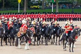 Major General's Review 2013: The Director of Music of the Household Cavalry, Major Paul Wilman, The Life Guards, during the Mounted Troops Ride Past. Behind him the kettle drummer from The Blues and Royals.. Horse Guards Parade, Westminster, London SW1,  United Kingdom, on 01 June 2013 at 11:51, image #587