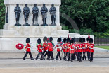 Trooping the Colour 2013: The 'Keepers of the Ground', guardsmen bearing marker flags for their respective regiments, turning towards Horse Guards Parade at the Guards Memorial. Image #25, 15 June 2013 09:53 Horse Guards Parade, London, UK