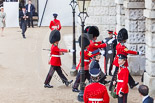 Trooping the Colour 2013: The 'Keepers of the Ground', guardsmen bearing marker flags for their respective regiments, disappearing under Horse Guards Arch, they will return later to mark the positions for their regiments. Image #27, 15 June 2013 09:55 Horse Guards Parade, London, UK