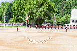 Trooping the Colour 2013: A wide angle view of Horse Guards Parade - the Band of the Grenadier Guards is marching along St. James's Park, with the Guards Memorial on the right, and the lake, and lots of spectators, on the left. Image #93, 15 June 2013 10:28 Horse Guards Parade, London, UK