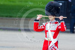 "Trooping the Colour 2013: The ""Lone Drummer"", Lance Corporal Christopher Rees, salutes with his drumsticks before re-joining the band. Image #428, 15 June 2013 11:16 Horse Guards Parade, London, UK"