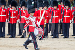 "Trooping the Colour 2013: The ""Lone Drummer"", Lance Corporal Christopher Rees,  marches forward to re-join the band. He passes the Ensign that will troop the Colour in a moment. Image #431, 15 June 2013 11:16 Horse Guards Parade, London, UK"