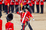 Trooping the Colour 2013: The Ensign, Second Lieutenant Joel Dinwiddle, marches foreward with the Colour, whilst Regimental Sergeant Major, WO1 Martin Topps, Welsh Guards, returns to the Escort to the Colour. Image #470, 15 June 2013 11:22 Horse Guards Parade, London, UK