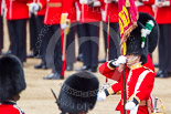 Trooping the Colour 2013: The Ensign, Second Lieutenant Joel Dinwiddle, marches foreward with the Colour, whilst Regimental Sergeant Major, WO1 Martin Topps, Welsh Guards, behind the Ensign, sword drawn, returns to the Escort to the Colour. Image #471, 15 June 2013 11:22 Horse Guards Parade, London, UK