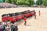 Trooping the Colour 2013: No. 5 Guard, F Company Scots Guards, during the March Past. In front, swords drawn, Major J A Hughes, Second Lieutenant P M Prys-Roberts, and Captain P W Foster. Image #550, 15 June 2013 11:37 Horse Guards Parade, London, UK