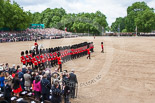 Trooping the Colour 2013: No. 6 Guard, No. 7 Company Coldstream Guards, during the March Past. In front, swords drawn, Major T P Y Radcliffe, Second Lieutenant J C Olley, and Captain C E B Starkey. Image #553, 15 June 2013 11:38 Horse Guards Parade, London, UK