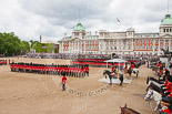 Trooping the Colour 2013: A wide angle overview of Horse Guards Parade during the March Past, with the Royal Colonels on both sides of the dais where HRH The Duke of Kent and HM The Queen are watching the March Past. Image #555, 15 June 2013 11:38 Horse Guards Parade, London, UK