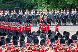 Trooping the Colour 2013: The March Past in Quick Time. The guards are marching beween the Massed Bands, in front, and the Blues and Royals behind them. The Colour Party and the Regimental Sergeant Major ar marching behind No.  Guard. Image #622, 15 June 2013 11:48 Horse Guards Parade, London, UK