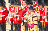 Trooping the Colour 2013: Senior Drum Major M J Betts, Grenadier Guards, gives the commands to move the Massed Bands out of the path of the Mounted Bands. Image #632, 15 June 2013 11:51 Horse Guards Parade, London, UK