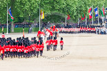 Trooping the Colour 2013: The March Off - the Massed Bands are leaving towards The Mall, followed by the glass coach carrying HM The Queen and HRH The Duke of Kent. Behind members of the Royal Procession, followed by No. 1 Guard, carrying the Colour. Image #845, 15 June 2013 12:12 Horse Guards Parade, London, UK