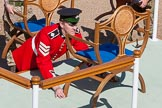The Colonel's Review 2015: An Irish Guards sergeant makes precision adjustments to one of the chairs on the dais.. Horse Guards Parade, Westminster, London,  United Kingdom, on 06 June 2015 at 09:35, image #19