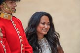 Woman with long black hair posing with a Coldstream Guards Captain for a photo before  The Colonel's Review 2018 (final rehearsal for Trooping the Colour, The Queen's Birthday Parade)  at Horse Guards Parade, Westminster, London, 2 June 2018, 09:14.