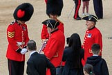 A Coldstream Guards Sergeant and Captain welcoming Chelsea Pensioners before The Colonel's Review 2018 (final rehearsal for Trooping the Colour, The Queen's Birthday Parade)  at Horse Guards Parade, Westminster, London, 2 June 2018, 09:19.