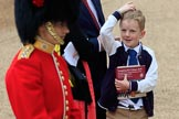 Young boy carrying an event programme and looking up to a Captain of the Coldstream Guards before The Colonel's Review 2018 (final rehearsal for Trooping the Colour, The Queen's Birthday Parade)  at Horse Guards Parade, Westminster, London, 2 June 2018, 09:46.