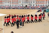 The 'Keepers of the Ground', guardsmen bearing marker flags for their respective regiments, marching towards Horse Guards Arch before The Colonel's Review 2018 (final rehearsal for Trooping the Colour, The Queen's Birthday Parade)  at Horse Guards Parade, Westminster, London, 2 June 2018, 09:53.