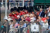 The Band of the Welsh Guards in the background, marching from The Mall to Horse Guards Parade during The Colonel's Review 2018 (final rehearsal for Trooping the Colour, The Queen's Birthday Parade)  at Horse Guards Parade, Westminster, London, 2 June 2018, 10:11.