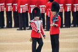 Duty Drummer Sam Orchard, marching around Colour Sentry Guardsman Jonathon Hughes (26), to uncase the Colour during The Colonel's Review 2018 (final rehearsal for Trooping the Colour, The Queen's Birthday Parade)  at Horse Guards Parade, Westminster, London, 2 June 2018, 10:33.