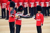 Duty Drummer  Sam Orchard uncasing the Colour held by Colour Sergeant Sam McAuley (31), with Colour Sentry Guardsman Jonathon Hughes (26) behind, during The Colonel's Review 2018 (final rehearsal for Trooping the Colour, The Queen's Birthday Parade)  at Horse Guards Parade, Westminster, London, 2 June 2018, 10:33.