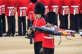 Duty Drummer  Sam Orchard uncasing the Colour. Behind him Colour Sentry Guardsman Jonathon Hughes (26) during The Colonel's Review 2018 (final rehearsal for Trooping the Colour, The Queen's Birthday Parade)  at Horse Guards Parade, Westminster, London, 2 June 2018, 10:33.