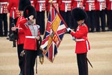Duty Drummer  Sam Orchard saluting the uncased Colour held by Colour Sergeant Sam McAuley (31), with Colour Sentry Guardsman Jonathon Hughes (26) behind, during The Colonel's Review 2018 (final rehearsal for Trooping the Colour, The Queen's Birthday Parade)  at Horse Guards Parade, Westminster, London, 2 June 2018, 10:33.
