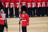 Colour Sergeant Sam McAuley (31) holding the uncased Colour, with Duty Drummer  Sam Orchard saluting, during The Colonel's Review 2018 (final rehearsal for Trooping the Colour, The Queen's Birthday Parade)  at Horse Guards Parade, Westminster, London, 2 June 2018, 10:33.