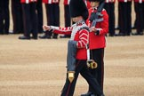 Duty Drummer Sam Orchard marching off with the Colour case, behind him Colour Sentry Guardsman Jonathon Hughes (26), during The Colonel's Review 2018 (final rehearsal for Trooping the Colour, The Queen's Birthday Parade)  at Horse Guards Parade, Westminster, London, 2 June 2018, 10:34.