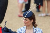 Female spectator wearing a fascinator with two long sticks before Trooping the Colour 2018, The Queen's Birthday Parade at Horse Guards Parade, Westminster, London, 9 June 2018, 09:14.