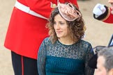 Curly haired woman wearing a fascinator before Trooping the Colour 2018, The Queen's Birthday Parade at Horse Guards Parade, Westminster, London, 9 June 2018, 09:15.