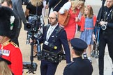 BBC Steadycam operator arrives at Horse Guards Parade, finding a way through the crowds before during Trooping the Colour 2018, The Queen's Birthday Parade at Horse Guards Parade, Westminster, London, 9 June 2018, 09:36.