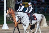 Two female Metropolitan Police officers on horseback, riding past the Youth Enclosure, before Trooping the Colour 2018, The Queen's Birthday Parade at Horse Guards Parade, Westminster, London, 9 June 2018, 09:47.