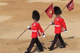 Two markers from Number Six Guard, F Company, Scots Guards marching with their flags to mark the position of their guard on arrival at Horse Guards Parade before Trooping the Colour 2018, The Queen's Birthday Parade at Horse Guards Parade, Westminster, London, 9 June 2018, 10:17.