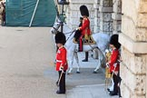 The Field Officer in Brigade Waiting, Lieutenant Colonel Edwyn Nicholas Launders MBE on horseback at Horse Guards Arch, with the Garrison Sergeant Major (GSM) Headquarters London District, Warrant Officer Class 1 Andrew (Vern) Strokes in front of him, at the start of Trooping the Colour 2018, The Queen's Birthday Parade at Horse Guards Parade, Westminster, London, 9 June 2018, 10:38.